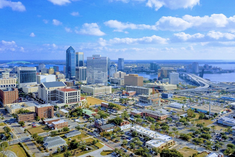 Contact - Aerial View of Downtown Jacksonville Florida on a Bright Sunny Day With Blue skies