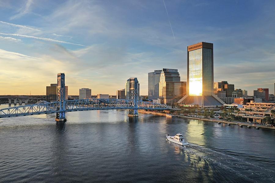 Jacksonville, FL - View of Downtown Jacksonville Florida Bridge and River at Dusk